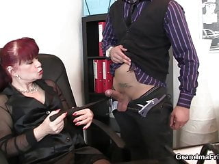 Business woman spreads her old pussy for two cocks