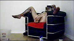 Restrained in fishnet catsuit taking the bbc dildo