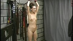 Brunette with tattooes and little titties submits to being bound and spanked raw