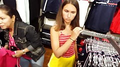 Candid voyeur teen yellow gym shorts shopping tight legs ass