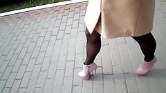 Fast walking on high heels on the paving slab
