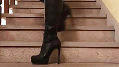 up and down the stairs in black thigh boots...