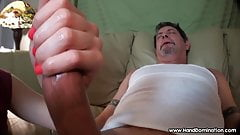 large curved cock gets Femdom handjob