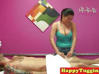 Asian masseuse wanking her massage client