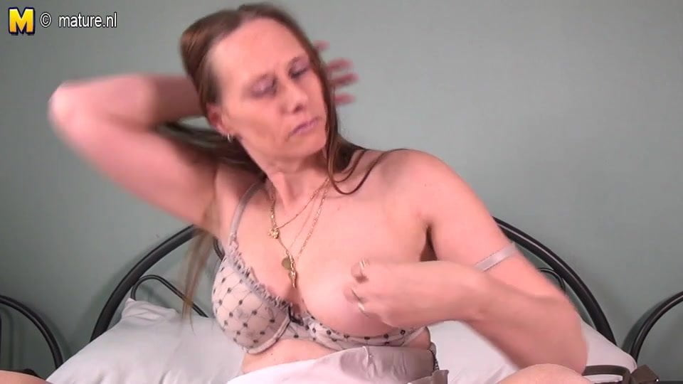 Horny real mother masturbating on her bed