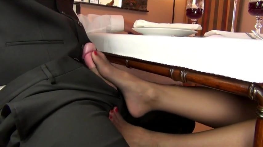 Under table footjob