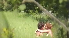 Young lovers having fun fucking on the meadow