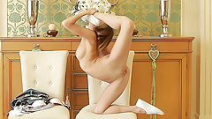 young skinny flexible gymnast stretching and fingering