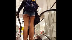 Candid voyeur hot thick teen ass booty shorts on escalator