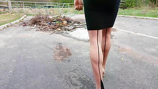 Walking in nude heels seamed hold-ups and tight black skirt
