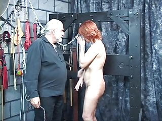 Download video bokep Mature redheaded slave with saggy tits is whipped in hippy's basement Mp4 terbaru
