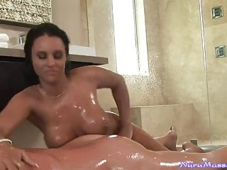 Busty Australian masseuse gives a Nuru gel massage