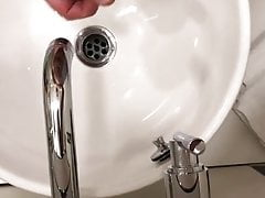 Jerking in a hotel bathroom