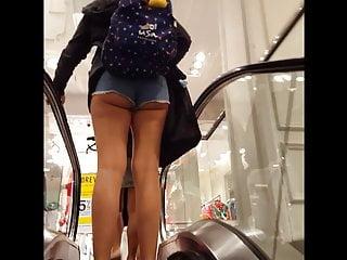 Candid voyeur hot thick teen ass booty shorts on escalator