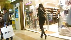 Russian woman in short skirt and high heel boots spying