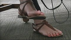 Sexy Chinese college girl dangles her feet while studying