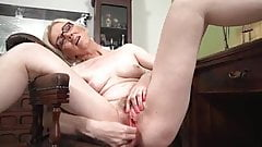 mature blonde solo masturbation on a desk