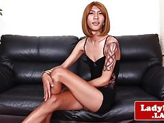 Inked asian trans with long legs jerks solo
