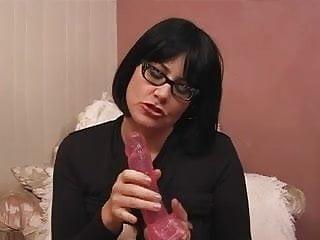 Hottie in glasses masturbating solo
