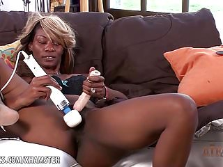 Ebony Desire rubs and toys her hungry exotic pussy