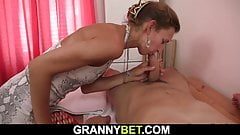 Old masseuse sucks and rides his cock
