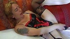 German woman in black stockings enjoys to masturbate