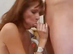 MILF fucking son's friend on the couch