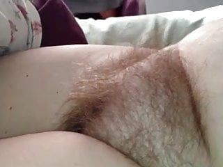 rubbing her soft pubic hairy mound & her big nipples.