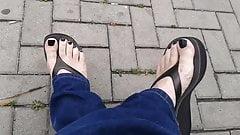 black toenail polish and black platform flip flops