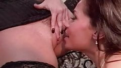 Two lesbians in the stairway with strap on anal.