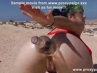 Proxy Paige with big wine bottle in ass & gape at the desert
