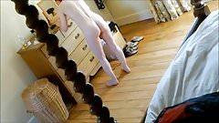 White as milk teen drying her hair
