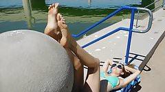 Darla in green bikini showing her stunning soles