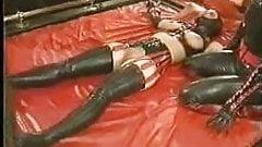 Latex Dildo pants being put on bondage girl