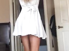Long-haired skinny babe strips off her dress shows her ass Thumbnail