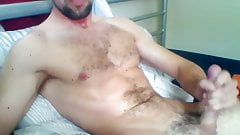 Muscle Hairy Guy Sprays His Body