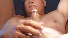 Handsome asian shooting hard