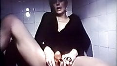 Lady Choking Snake On Toilet