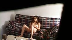 hidden cam catches asian girl on couch
