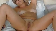 Hot mature woman enjoys her vibrator until squirts
