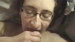 Girl with glasses gives passionate blowjob