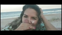Wife lets her lover cum over her face at the beach
