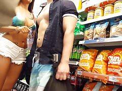 Candid voyeur Latina in shiny bikini top