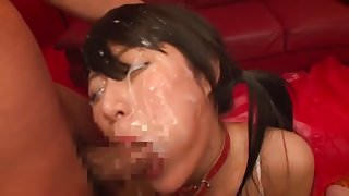 Asian girl sucks cocks with a face full of cum