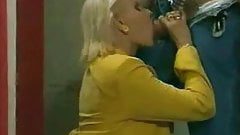 Mature Blond having sex in a toilet