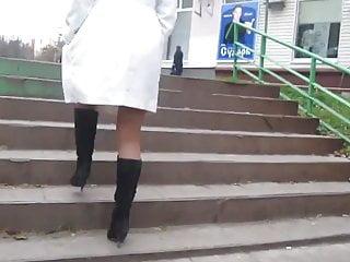White coat, black boots, tan stockings
