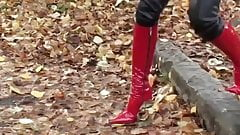 hot girl walking in leatherfetish panty, corset & red boots