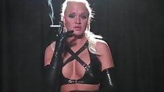 Blonde girl smoking in long latex gloves