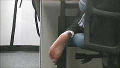 Cute Muslim girl barefoot soles in library