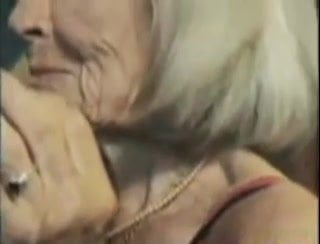 Granny with saggy tits seduces young stud and fucks him